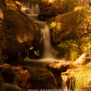 Sun Shining On Waterfall