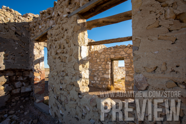 Dilapidated Building, Two Guns